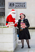 Santa and Francis Crook, cheif executive of The Howard League, along with  English PEN deliver books for prisoners to the Ministry of Justice HQ, central London.