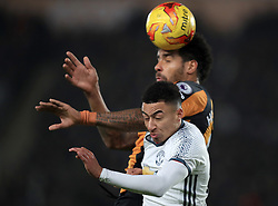 Hull City's Tom Huddlestone and Manchester United's Jesse Lingard battle for the ball