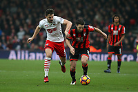 Football - 2016 / 2017 Premier League - AFC Bournemouth vs. Southampton<br /> <br /> Southampton's Jay Rodriguez grabs Bournemouth's Harry Arter to try and stop the Bournemouth man from setting up an attack at Dean Court (The Vitality Stadium) Bournemouth<br /> <br /> COLORSPORT/SHAUN BOGGUST