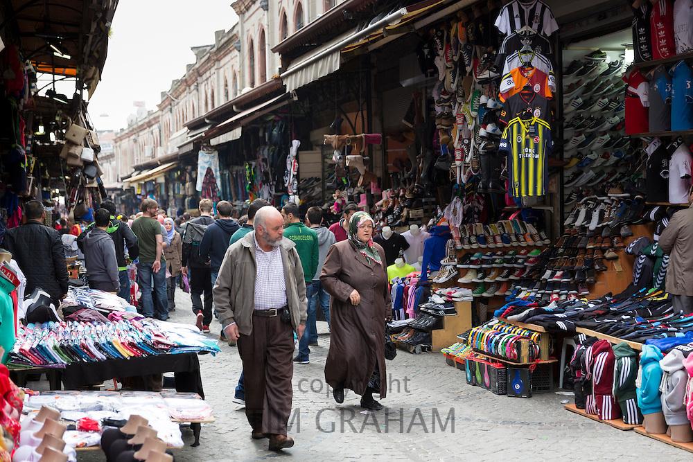 Muslim couple shopping in The Grand Bazaar, Kapalicarsi, great market in Beyazi, Istanbul, Turkey