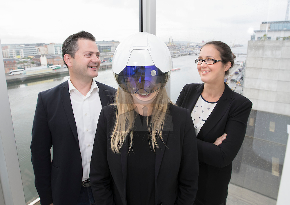 """Repro Free: 13/06/2016 Leah Brophy, Trainee Solicitor, Matheson is pictured wearing the DAQRI Smart Helmet during Smart Week at law firm Matheson with Paul Sweeney, VP Sales, DAQRI (left) and Rebecca Ryan, Partner, Matheson.<br /> <br /> The leading Irish law firm is embracing a digital future for its """"Smart Week"""" which runs from 13-17 June and will promote tech best practice and highlight the tech innovations that are pivotal in providing best-in-class legal services to clients across all sectors. As part of the Smart Week initiative, Matheson will host a Tech Forum, with keynote addresses on business innovation with guest speakers from Microsoft, Airbnb and Daqri, and a panel discussion.<br /> <br /> Matheson, headquartered in Dublin with offices in London, New York and Palo Alto, employ over 600 people in Dublin. The firm advise seven of the top 10 global technology brands and over half of the world's 50 largest banks.<br /> <br /> ENDS<br /> For further info contact:<br /> Katy Stokes<br /> Director of Marketing<br /> Matheson<br /> D: +353 1 232 2103<br /> T: +353 1 232 2000<br /> F: +353 1 232 3333<br /> E: katy.stokes@matheson.com"""