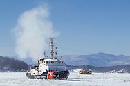 The United States Coast Guard cutter Sturgeon Bay breaks ice in the shipping channel on the Hudson River near Hudson, New York.