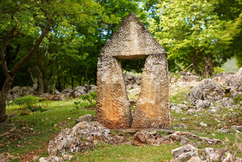 Symbolic Croatian sculptures in  the protected sub- Mediterranean broad leaved deciduous forest of  Tramutana, Cres Island, Croatia