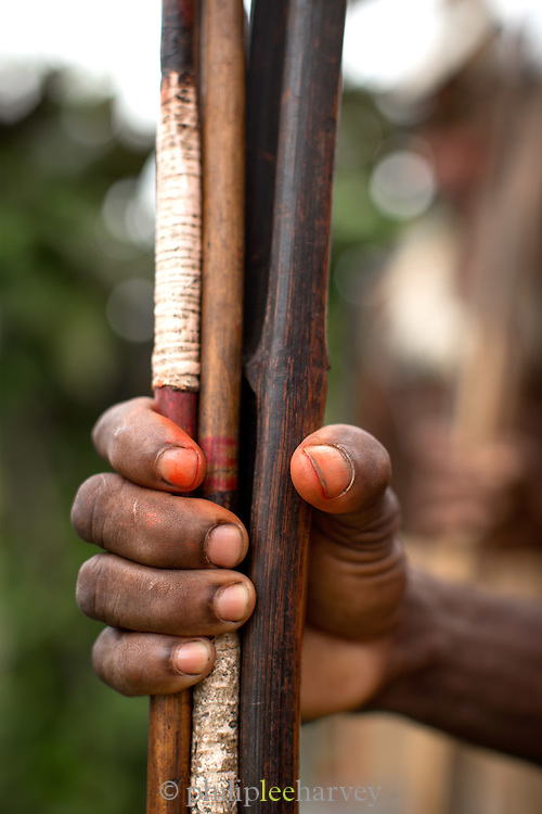 Man holding bow and arrows, Miwa Village, Lake Murray, Middle Fly District, Western Province, Papua New Guinea