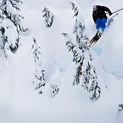Owen Dudley drops into a powder filled gully in the Mount Baker backcountry.