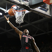 Louisville Guard Terry Rozier grabs a rebound during an NCAA basketball game between the 14th ranked Louisville Cardinals and the UCF Knights at the CFE Arena on Tuesday, December 31, 2013 in Orlando, Florida. (AP Photo/Alex Menendez)