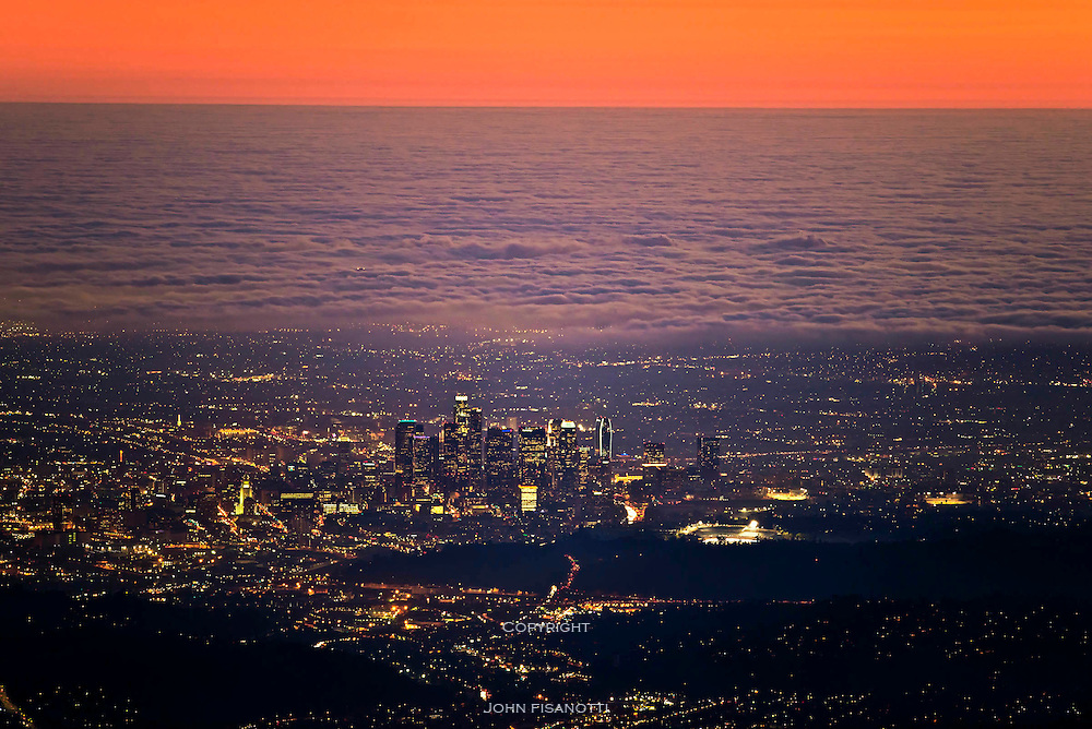 Viewed from Mt. Wilson at dusk, the marine layer extends from downtown Los Angeles to the sea.