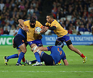 Viorel Lucaci (Romania) trying to burst through a tough French defence during the Rugby World Cup Pool D match between France and Romania at the Queen Elizabeth II Olympic Park, London, United Kingdom on 23 September 2015. Photo by Matthew Redman.