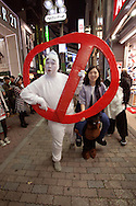 October 29, 2016, Tokyo, Japan: In the Shibuya district, the heart of Japanese youth culture, Halloween celebrations have exploded in the past few years. Up until this boom, Halloween celebrations were minimal across the city. But Shibuya has now become Halloween central with tens of thousands of costumed party goers invading it's streets to promenade en-costume or hit club events in the area. This informal street gathering has become so big, this year the Tokyo Metropolitan Police Dept. decided to close off two main streets adjacent to Shibuya Station. When Oct. 31 falls on a weekday, ninety percent of Halloween celebrations across Japan take place on the preceding Saturday. Pictured here are Ghost Busters costumes.(Torin Boyd/Polaris).