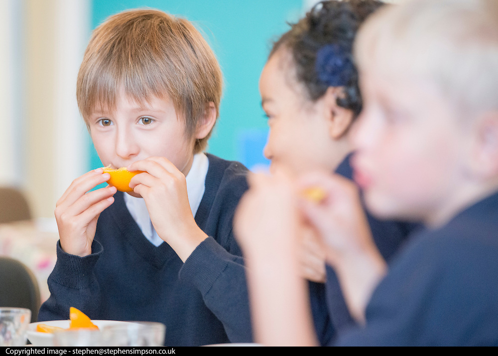 © Licensed to London News Pictures. 02/09/2014. London, UK. Children eat breakfast.  Deputy Prime Minister Nick Clegg launches free school meals at Clapham Manor Primary School in Lambeth today 2nd September 2014. For many school returning from the school holidays this is the first day of the Governments universal infant free school meals.  Photo credit : Stephen Simpson/LNP