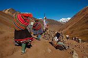 Pilgrims walk during of 8 kilometres to the Sanctuary of the Lord of Qoyllur Rit'i (The Lord of the Shining Snow) at the top of the mountain they pray to the Apus (mountains) in Cusco, Peru.