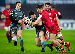 Luke Morgan of Ospreys under pressure from Alex Lewington of Saracens<br /> <br /> Photographer Simon King/Replay Images<br /> <br /> European Rugby Champions Cup Round 5 - Ospreys v Saracens - Saturday 11th January 2020 - Liberty Stadium - Swansea<br /> <br /> World Copyright © Replay Images . All rights reserved. info@replayimages.co.uk - http://replayimages.co.uk