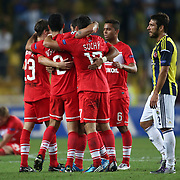 Fenerbahce's Egemen Korkmaz (R) and Spartak Moscow's players celebrate victory during their UEFA Champions League Play-Offs, 2nd leg soccer match Fenerbahce between Spartak Moscow at Sukru Saracaoglu stadium in Istanbul Turkey on Wednesday 29 August 2012. Photo by TURKPIX