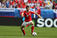 Gareth Bale of Wales in action.Euro 2016, Wales v Slovakia at Matmut Atlantique , Nouveau Stade de Bordeaux  in Bordeaux, France on Saturday 11th June 2016, pic by  Andrew Orchard, Andrew Orchard sports photography.