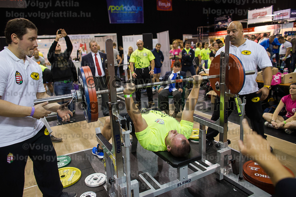 Participant compete in a bench press competition at the FitParade mass sports event in Budapest, Hungary on October 17, 2015. ATTILA VOLGYI