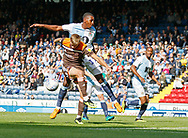 Marcus Forss of Brentford misses his kick under pressure from Blackburn Rovers Amari'i Bell  during the EFL Sky Bet Championship match between Blackburn Rovers and Brentford at Ewood Park, Blackburn, England on 25 August 2018.
