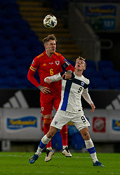 CARDIFF, WALES - Wednesday, November 18, 2020: Wales' Joe Rodon (L) and Finland's substitute Marcus Forss during the UEFA Nations League Group Stage League B Group 4 match between Wales and Finland at the Cardiff City Stadium. Wales won 3-1 and finished top of Group 4, winning promotion to League A. (Pic by David Rawcliffe/Propaganda)