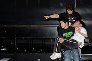 A wrestler is helped into the ring before his bout. Any level of disability is OK for wrestlers.
