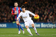 Ki Sung-Yueng of Swansea City in action. Barclays Premier League match, Crystal Palace v Swansea city at Selhurst Park in London on Monday 28th December 2015.<br /> pic by John Patrick Fletcher, Andrew Orchard sports photography.
