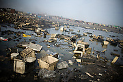 Computer monitor casings and other trash litter an area located near Agbogboloshie market in Accra, Ghana on Tuesday August 12, 2008.