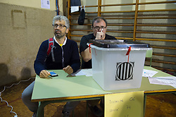 "© Licensed to London News Pictures. 01/10/2017. Barcelona, Spain.  <br /> <br /> Members of the organization during the voting at Sedeta de Gracia´s Centre Civic poll station.<br /> <br /> Students, their parents, associations and neighbours have organized to carry out ""playful activities"" during the weekend and keep open the Sedeta de Gracia´s Centre Civic.<br />  <br /> Since early in the morning dozens of people wait at the college´s door for the voting time under the rain.<br /> <br /> Mossos d´Escuadra said they won´t do nothing if that can destabilize social order.<br /> <br /> Catalonia is awaiting for today, October 1st, when the Spanish Region wants to vote in a self-determination referendum to get a independence.<br /> <br /> The Referendum´s Law was passed on last September 6th at the Catalonian Parliament thanks to the votes of ""Junts pel Sí"" and ""CUP"". Then it was suspended by the Spanish Constitutional Court, on next day.<br /> Carles Puigdemont, the President of the Government of Catalonia, said he would ignore that and he and his Government will continue with the Referendum.<br /> <br /> The Spanish Government has sent to Catalonia thousands of ""Guardia Civil"" and ""Policía Nacional"" officers (two of the Spanish forces and state security forces), to enforce the ruling of the Constitutional Court and avoid the voting process on next Sunday. They will work with the Mossos d´Escuadra (the Autonomic police in Catalonia).<br /> <br /> To avoid the vote, the Spanish Government has prevented the opening of polling stations, some of which are schools.  <br /> <br /> Photo credit: Gustavo Valiente/LNP"