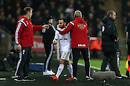 Leon Britton © of Swansea city is congratulated by his Alan Curtis, the Swansea city caretaker manager after he is replaced. Barclays Premier league match, Swansea city v West Bromwich Albion at the Liberty Stadium in Swansea, South Wales  on Boxing Day Saturday 26th December 2015.<br /> pic by  Andrew Orchard, Andrew Orchard sports photography.