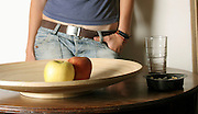 Young teen and food. a conceptual image for eating disorders