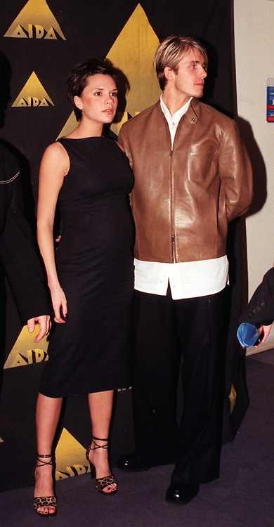 England and Manchester United footballer David Beckham and his fiancee Victoria Adams, of the Spice Girls, at the launch of the Aida project a Disney stage musical written by Elton John and Tim Rice. The launch took place at the Whitfield Recording Studios, London.