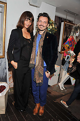 Left to right, HELENA CHRISTENSEN and MATTHEW WILLIAMSON at the launch of Maison Triumph, 71 Monmouth Street, Covent Garden, London on 14th February 2013.