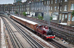© Licensed to London News Pictures. 22/06/2019. London, UK. A Metropolitan Locomotive No 1 steam engine pulls a set of vintage coaches as it approaches Barons Court Underground station to celebrate the 150th anniversary of the district line. London Transport Museum is running steam services, with vintage coaches, between Ealing Broadway and High Street Kensington over this weekend. Photo credit: Peter Macdiarmid/LNP
