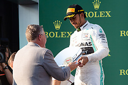 March 17, 2019 - Albert Park, VIC, U.S. - ALBERT PARK, VIC - MARCH 17: Mercedes-AMG Petronas Motorsport driver Lewis Hamilton (44) receives the second place trophy at The Australian Formula One Grand Prix on March 17, 2019, at The Melbourne Grand Prix Circuit in Albert Park, Australia. (Photo by Speed Media/Icon Sportswire) (Credit Image: © Steven Markham/Icon SMI via ZUMA Press)