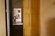 A corridor in the villa. Prieure de St Jean de Bebian. Pezenas region. Languedoc. The villa. A door. France. Europe.