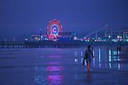 Woman walking on Santa Monica Beach, Santa Monica Pier, California, USA