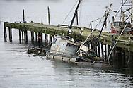 Swamped boat, needs help.