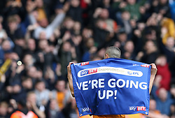 Wolverhampton Wanderers' Romain Saiss celebrates promotion at the end of the match at the Molineux ground