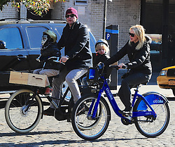 Naomi Watts and Liev Schreiber are seen enjoying a sunny Saturday out with their two son's Alexander and Samuel for a bicycle ride around SoHo, New York City, NY, USA on October 26, 2013. Photo by Morgan Dessalles/ABACAPRESS.COM  | 419925_001 New York City Etats-Unis United States