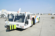 Israel, Ben-Gurion international Airport cargo transport vehicle in front of an airliner