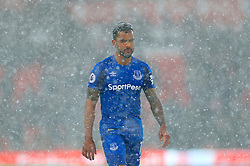 Everton's Theo Walcott in the snow during the Premier League match at the bet365 Stadium, Stoke.