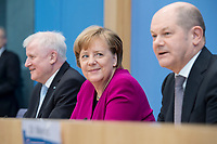 12 MAR 2018, BERLIN/GERMANY:<br /> Horst Seehofer (L), CSU, desig. Bundesinnenminister, Angela Merkel (M), CDU, Bundeskanzlerin, und Olaf Scholz (R), SPD, desig. Bundesfinanzminister, waehrend einer Pressekonferenz zum Koalitionsvertrag der CDU/CSU und SPD, Bundespressekonferenz<br /> IMAGE: 20180312-01-016
