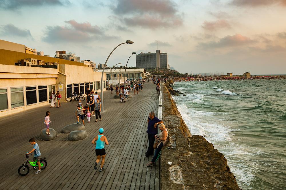 People enjoy a summer afternoon at the Tel Aviv Port in Tel Aviv's Tzafon Yashan neighborhood