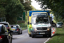 Wendover, UK. 10th October, 2021. An ambulance on an emergency call is delayed by road restrictions put in place by contractors working on behalf of HS2 Ltd during an operation to evict environmental activists opposed to the high-speed rail link from Wendover Active Resistance (WAR) camp. WAR camp, which contains tree houses, tunnels, a cage and a 15-metre tower, is currently the largest of the protest camps set up by Stop HS2 activists along HS2's Phase 1 route between London and Birmingham.