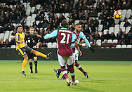 Arsenal's Alex Oxlade-Chamberlain scoring his sides fourth goal during the Premier League match at the London Stadium, London. Picture date December 3rd, 2016 Pic David Klein/Sportimage