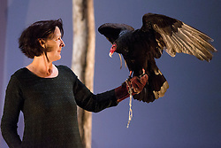 """***LNP BEST OF WEEK SELECTION***© Licensed to London News Pictures. 06/05/2014. London, England. Pictured: Fiona Shaw performing with Inti, a six-year old Turkey Vulture (Cathartes aura). """"The Testament of Mary"""" performed by actress Fiona Shaw at the Barbican Theatre, London. Running from 1 to 25 May 2014. Directed by Deborah Warner based on the novel by Colm Tóibín. Photo credit: Bettina Strenske/LNP"""