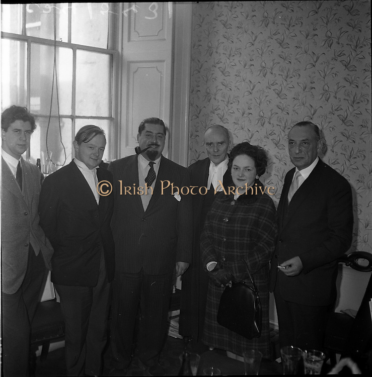 """25/01/1962<br /> 01/25/1962<br /> 25 January 1962<br />  Dr Paul Singer (with pipe), celebrates his acquittal following the longest trial in State history up to that time, the trial lasted 47 days until Mr Justice Walsh directed the jury to return a """"not guilty"""" verdict on eight counts of fraud arising from the operations of Shanahan's Stamp Auctions Ltd, Dun Laoghaire. It was Singer's 262nd day in court since proceedings were started against him four years earlier.  Also present is Senior Council, Mr. Sean McBride, third from left and Mrs Irma Singer,second from left."""