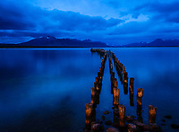 PUERTO NATALES, CHILE - CIRCA FEBRUARY 2019:  View of an old jetty in Puerto Natales at dawn. Puerto Natales is closest town to  Torres del Paine National Park in Chile and a very popular tourist destination.