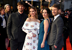 Michiel Huisman (left to right), Lily James, Jessica Brown Findlay and Glen Powell attending the world premiere of The Guernsey Literary and Potato Peel Pie Society at the Curzon Mayfair, London. Photo credit should read: Doug Peters/EMPICS Entertainment