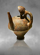 Terra cotta side spouted pitcher with lid - 1700 BC to 1500 BC - Kültepe Kanesh - Museum of Anatolian Civilisations, Ankara, Turkey .<br /> <br /> If you prefer to buy from our ALAMY STOCK LIBRARY page at https://www.alamy.com/portfolio/paul-williams-funkystock/hittite-art-antiquities.html  - Type Kultepe into the LOWER SEARCH WITHIN GALLERY box. Refine search by adding background colour, place, museum etc<br /> <br /> Visit our HITTITE PHOTO COLLECTIONS for more photos to download or buy as wall art prints https://funkystock.photoshelter.com/gallery-collection/The-Hittites-Art-Artefacts-Antiquities-Historic-Sites-Pictures-Images-of/C0000NUBSMhSc3Oo
