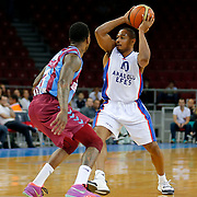 Anadolu Efes's Dontaye Draper (R) during their Turkish Basketball League Play Off Semi Final round 1 match Anadolu Efes between Trabzonspor at Abdi Ipekci Arena in Istanbul Turkey on Friday 29 May 2015. Photo by Aykut AKICI/TURKPIX
