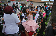Te'airah Gaylord and Raymond Solomon dance their way along the red carpet Friday, May 2, 2014 with family, friends and neighbors at their prom send-off party in an Austin backyard. Te'airah, 17, is a senior at Notre Dame High School for Girls and the celebration was at her grandmother and great-grandmother's home. (Brian Cassella/Chicago Tribune) B583688985Z.1 <br /> ....OUTSIDE TRIBUNE CO.- NO MAGS,  NO SALES, NO INTERNET, NO TV, CHICAGO OUT, NO DIGITAL MANIPULATION...