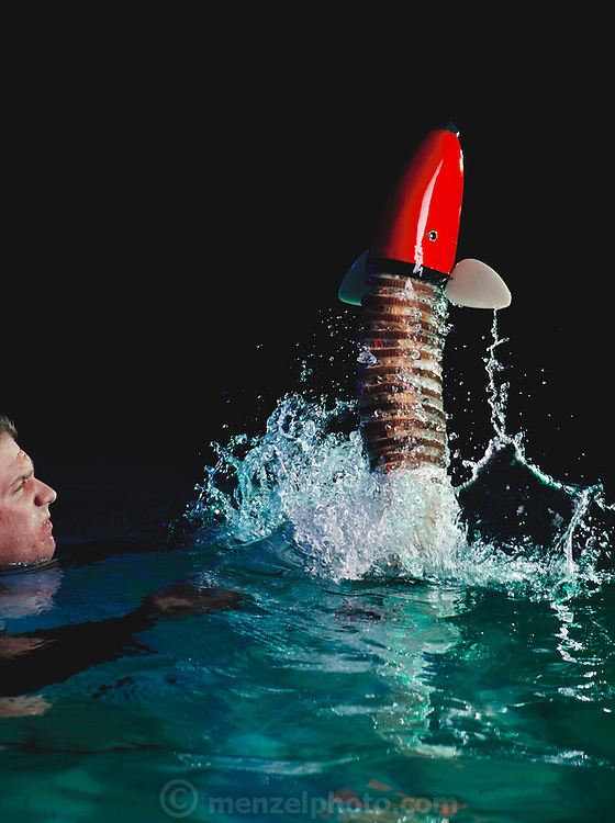 For a photo-illustration, graduate student Josh Davis (underwater, in a wet-suit) helps the RoboPike breach out of the water in order to show how well the robotic fish might be able to swim one day. The idea for the image of the RoboPike breaching came from the head of Ocean Engineering, Professor Triantafyllou, whose dream it is for a robotic fish to swim well enough to be able to jump out of the water Massachusetts Institute of Technology, Cambridge, MA, USA.
